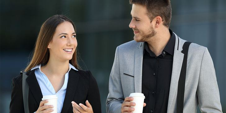 How to Tell If a Guy Likes You At Work: 17 Subtle Signs He's